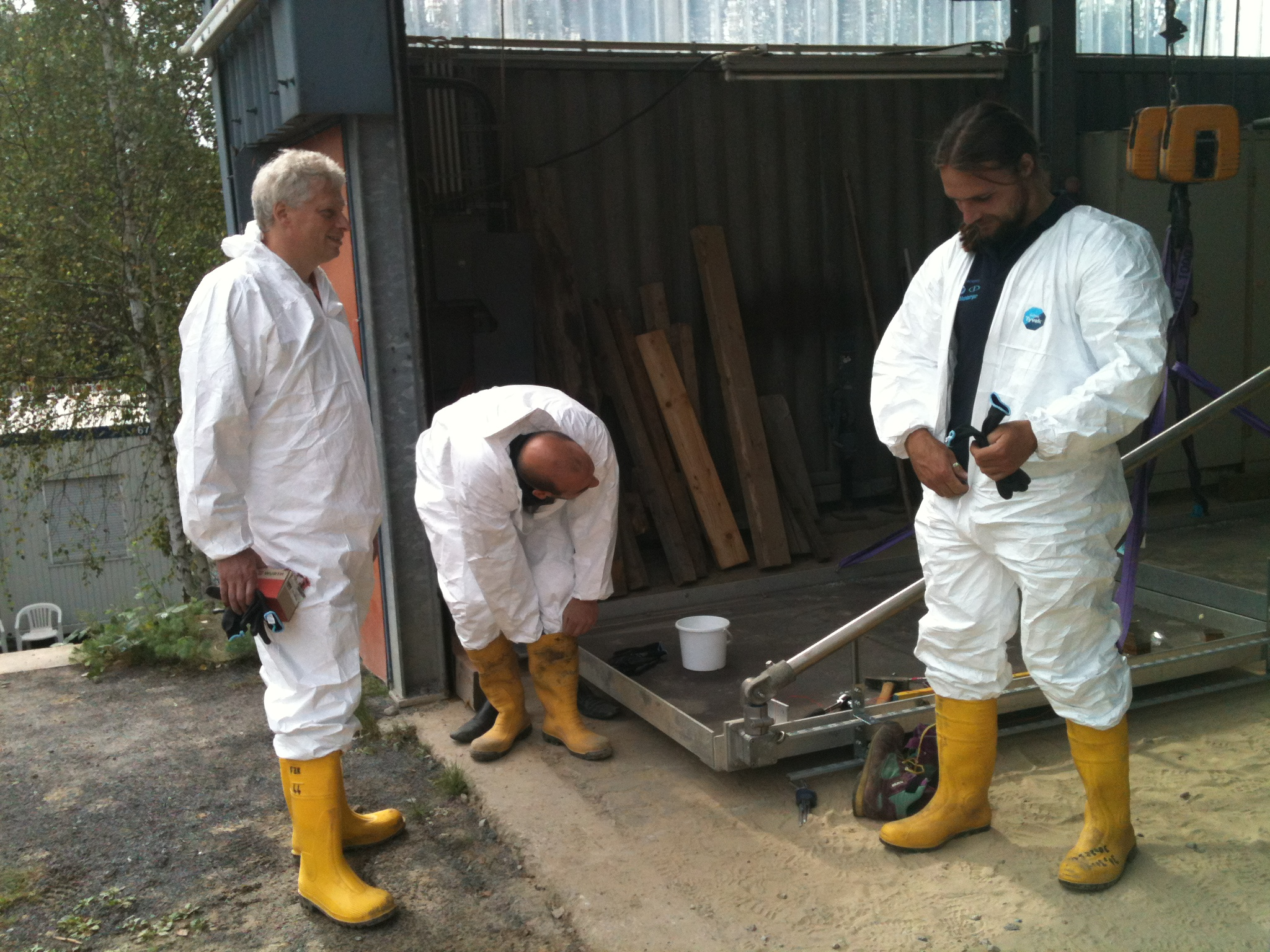 Tjeerd, Kostas, and Ben get kitted out for some serious concreting...